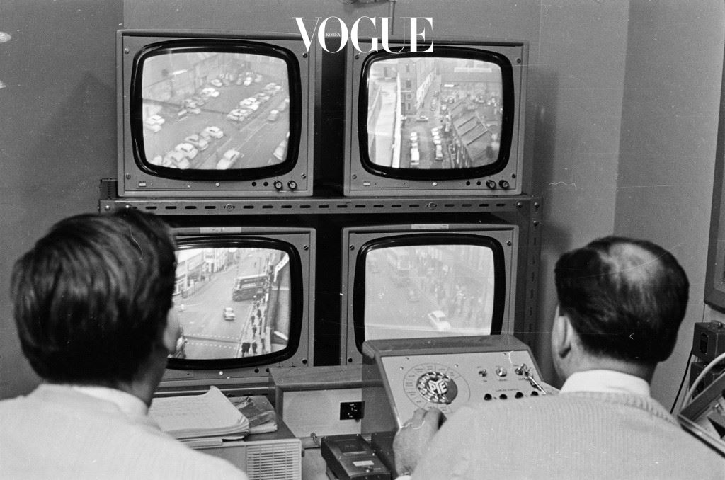 4th January 1968:  Security men watching the images relayed from police CCTV (Closed Circuit Television) cameras overlooking a street in Croydon, south London.  (Photo by William Lovelace/Express/Getty Images)