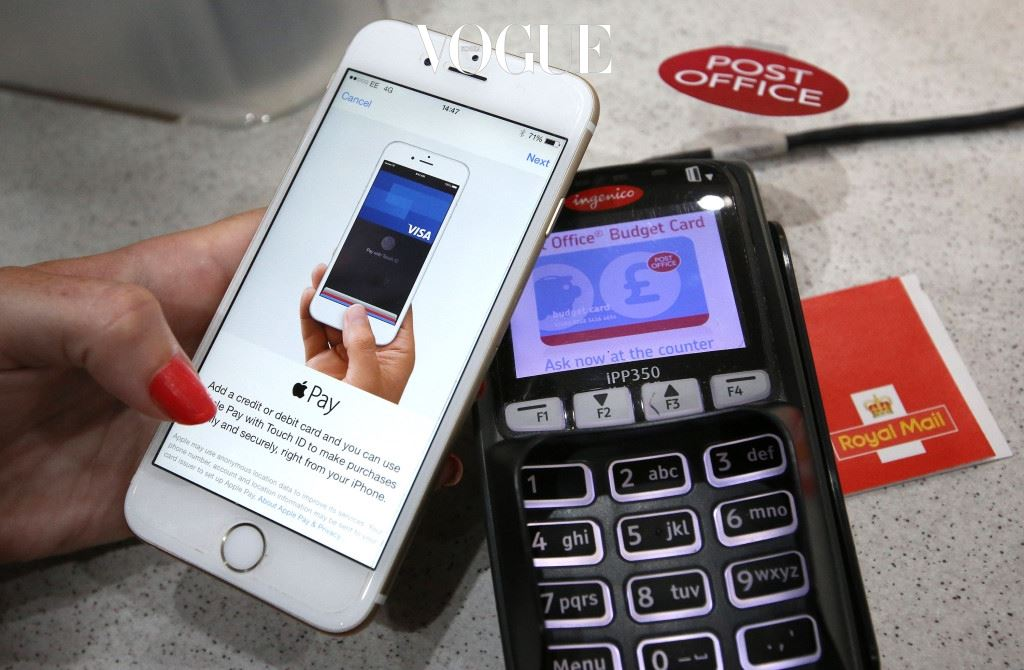 LONDON, ENGLAND - JULY 14:  In this photo illustration, an iPhone is used to make an Apple Pay  purchase at The Post Office on July 14, 2015 in London, England. From today iPhone and Apple Watch owners can use their device to pay for purchases at retailers who support the new mobile wallet service Apple Pay.  (Photo by Peter Macdiarmid/Getty Images)