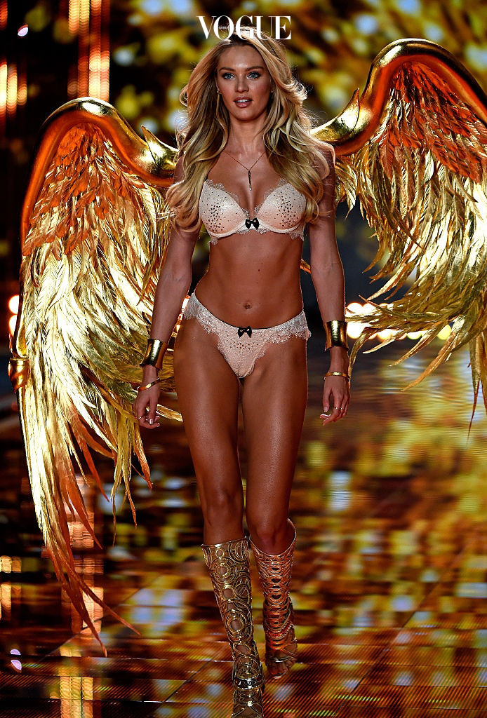 LONDON, ENGLAND - DECEMBER 02:  Model Candice Swanepoel walks the runway at the annual Victoria's Secret fashion show at Earls Court on December 2, 2014 in London, England.  (Photo by Pascal Le Segretain/Getty Images)