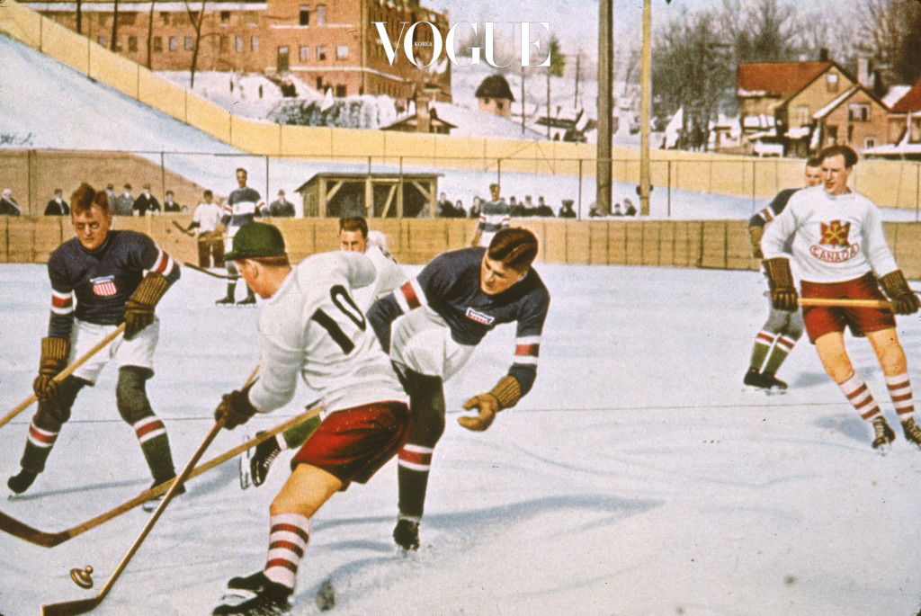 An American hockey play attempts to sweep the puck away from a Canadian in a match between their two countries in the 1932 Lake Placid Olympics, early February, 1932. (Photo by Hulton Archive/Getty Images)