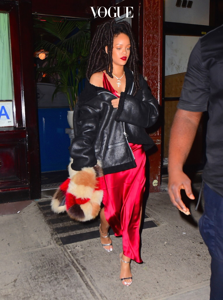"""Rihanna was spotted leaving Carbone Italian Restaurant in NYC on Wednesday night. The singer enjoyed a late night meal , before leaving at 3am. She wore a red silk dress, with a black shearling jacket, and a multicolored Fur scarf. She showed off her long legs with an extremely high split in her dress. She was joined by her """"Live Your Life"""" collaborator, Rapper T.I. , as well as the ever popular DJ Khaled  Pictured: Rihanna Ref: SPL1368876  061016   Picture by: 247PAPS.TV / Splash News Splash News and Pictures Los Angeles:310-821-2666 New York:212-619-2666 London:870-934-2666 photodesk@splashnews.com"""