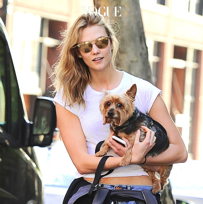 Karlie Kloss looking naturally gorgeous as she holds her yorkie puppy while going for a walk in the West Village. She went for a casual look wearing a white tee and boyfriend jeans in NYC. She is being credited at the Times 100 as one of the 100 most influential people. Pictured: Karlie Kloss Ref: SPL1269802  240416   Picture by: Splash News Splash News and Pictures Los Angeles:310-821-2666 New York:212-619-2666 London:870-934-2666 photodesk@splashnews.com