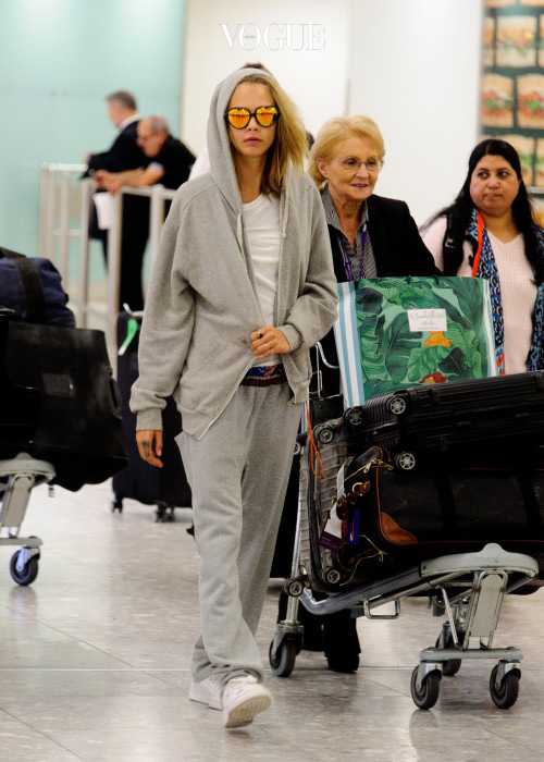EXCLUSIVE: Cara Delevingne and sister Poppy arrive at Heathrow Airport from Los Angeles and are met by a friend in Terminal 3 with Cara's pet dog Leo. Pictured: Cara Delevingne Ref: SPL1349994  090916   EXCLUSIVE Picture by: Steve Bagness/Splash News Splash News and Pictures Los Angeles:310-821-2666 New York:212-619-2666 London:870-934-2666 photodesk@splashnews.com