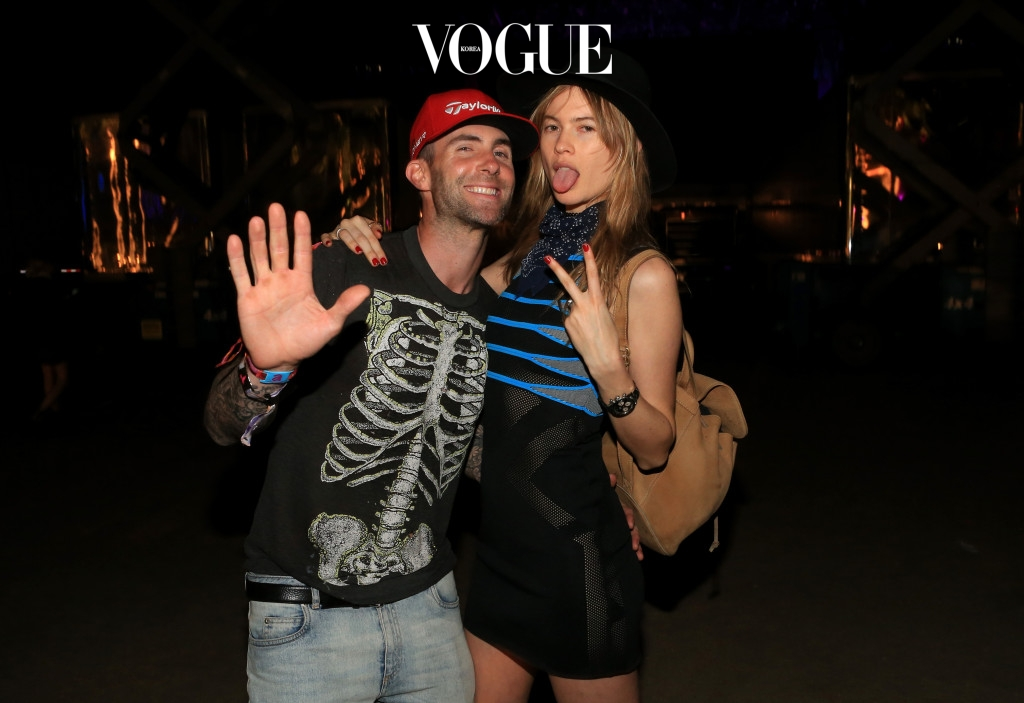 INDIO, CA - APRIL 10: Musician Adam Levine (L) and model Behati Prinsloo attend day 1 of the 2015 Coachella Valley Music & Arts Festival (Weekend 1) at the Empire Polo Club on April 10, 2015 in Indio, California.  (Photo by Christopher Polk/Getty Images for Coachella)