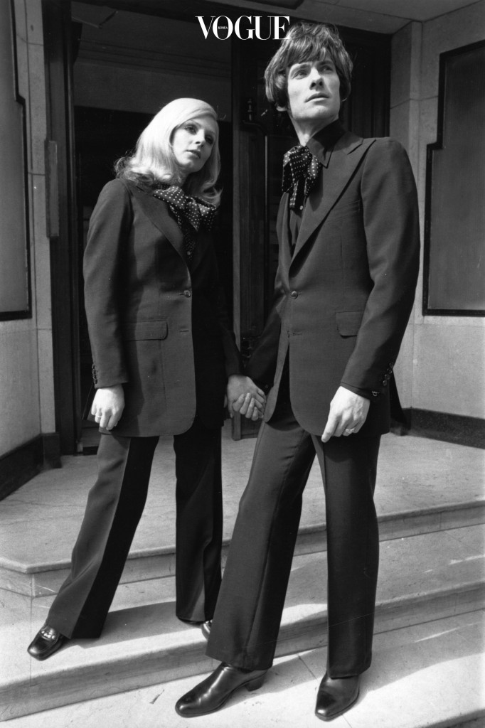 Two models wearing identical 'his and hers' suits.    (Photo by Evening Standard/Getty Images)