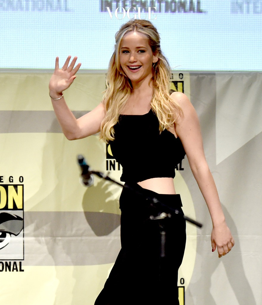 """SAN DIEGO, CA - JULY 09:  Actress Jennifer Lawrence waves at the audience during at the """"The Hunger Games: Mockingjay Part 2"""" panel during Comic-Con International 2015 at the San Diego Convention Center on July 9, 2015 in San Diego, California.  (Photo by Kevin Winter/Getty Images)"""