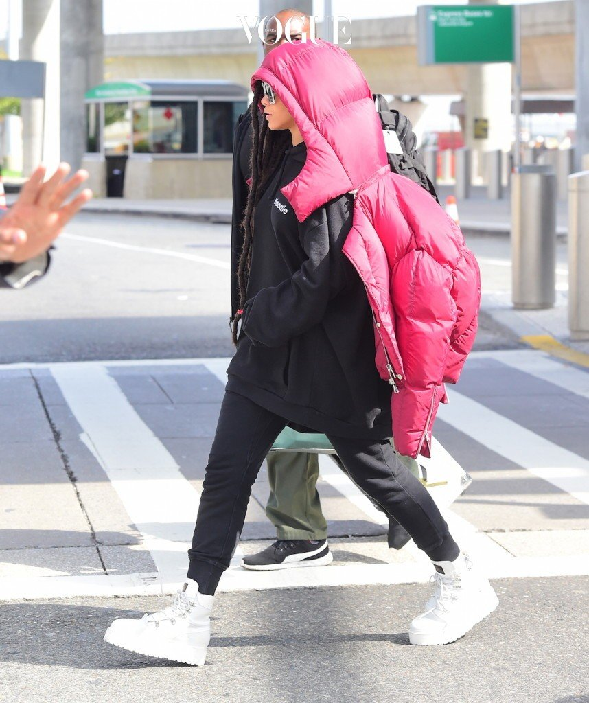 EXCLUSIVE: Rihanna was spotted landing in NYC on Monday afternoon, after taking an immediate flight from Paris in the wake of Kim Kardashian's Armed Robbery. After presenting her Fenty x Puma SS17 Collection, and attending the Dior Fashion show, Rihanna was planning  to spend a few days in the City of Love, but instead changed her plans and flew straight to NYC. She showed off her drastic new hairstyle, with hip length Dreadlocks. She appeared in great spirits despite the tense moments overseas.  Pictured: Rihanna Ref: SPL1367555  031016   EXCLUSIVE Picture by: 247PAPS.TV / Splash News Splash News and Pictures Los Angeles:310-821-2666 New York:212-619-2666 London:870-934-2666 photodesk@splashnews.com