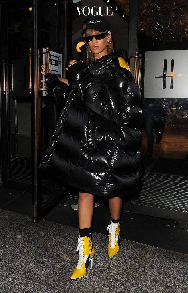 Rihanna dazzles in a black coat and yellow ankle boots as she is seen on shopping trip arriving at Harrods London, UK.  Pictured: Rihanna Ref: SPL1332199  200816   Picture by: RV/ Splash News Splash News and Pictures Los Angeles:310-821-2666 New York:212-619-2666 London:870-934-2666 photodesk@splashnews.com