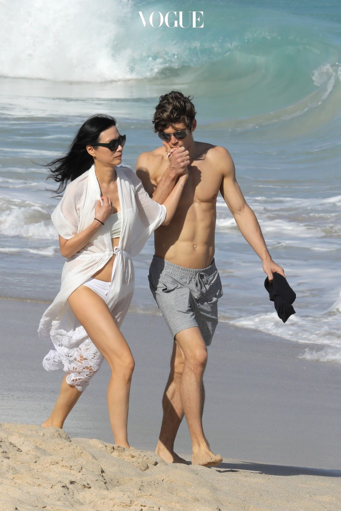 EXCLUSIVE: Rupert Murdoch¿s famed ex-wife Wendi Deng shows off her new toyboy romance during her St Barts vacation on Wednesday (dec 28). The 47-year-old fashionista walked hand in hand on the beach with handsome Hungarian model Bertold Zahoran, 32. The 6ft 2ins hunk showed off his six pack as the two took a relaxing stroll while Deng wore black shades, a white cover up and matching bikini.  Pictured: Wendi Deng Ref: SPL1414209  291216   EXCLUSIVE Picture by: Splash News Splash News and Pictures Los Angeles:310-821-2666 New York:212-619-2666 London:870-934-2666 photodesk@splashnews.com