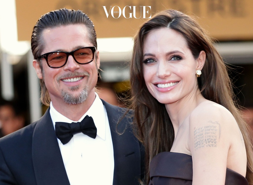 """CANNES, FRANCE - MAY 16:  Angelina Jolie (R) and Brad Pitt attend """"The Tree Of Life"""" premiere during the 64th Annual Cannes Film Festival at Palais des Festivals on May 16, 2011 in Cannes, France.  (Photo by Andreas Rentz/Getty Images)"""