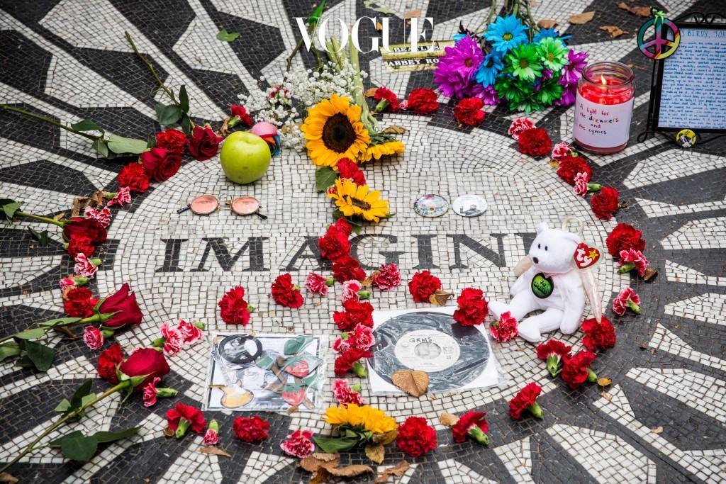 """NEW YORK, NY - OCTOBER 09:  The """"Imagine"""" tile mosaic in the Strawberry Fields section of Central Park, created to honor John Lennon, is seen on October 9, 2014 in New York City. Lennon was murdered nearby in 1980; today would have been his 74th birthday.  (Photo by Andrew Burton/Getty Images)"""