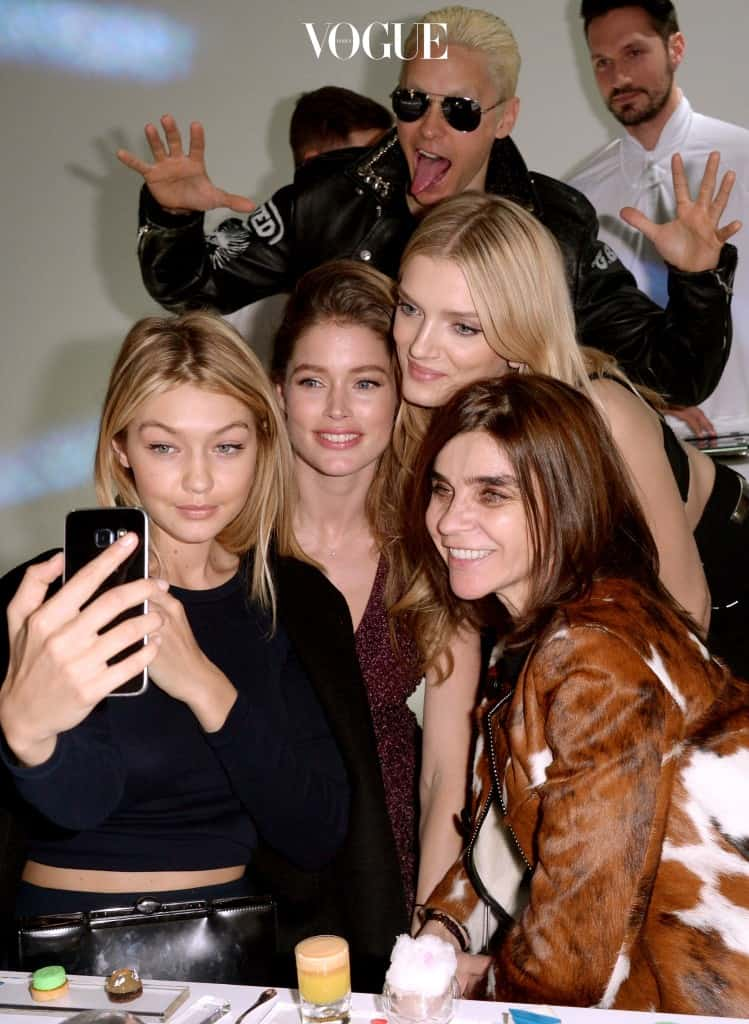 PARIS, FRANCE - MARCH 07:  (L-R) Gigi Hadid, Doutzen Kroes, Lily Donaldson, Jared Leto and Carine Roitfeld attend the Paris Fashion Week Tasting Night with Galaxy featuring Brad Goreski, model Jessica Stam and Executive Vice President of Global Marketing, IT & Mobile Division at Samsung Electronics, Younghee Lee  at Four Seasons Hotel George V on March 7, 2015 in Paris, France.  (Photo by Francois Durand/Getty Images for Samsung)