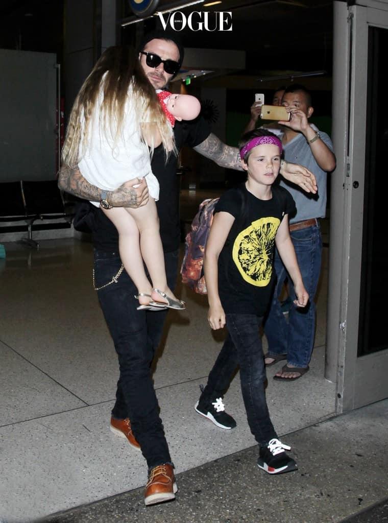 NO JUST JARED USAGE David Beckham and Kids arriving at the Los Angeles International Airport. Pictured: David Beckham, Harper Beckham, Romeo Beckahm Ref: SPL1316879  110716   Picture by: Splash News Splash News and Pictures Los Angeles:310-821-2666 New York: 212-619-2666 London:870-934-2666 photodesk@splashnews.com