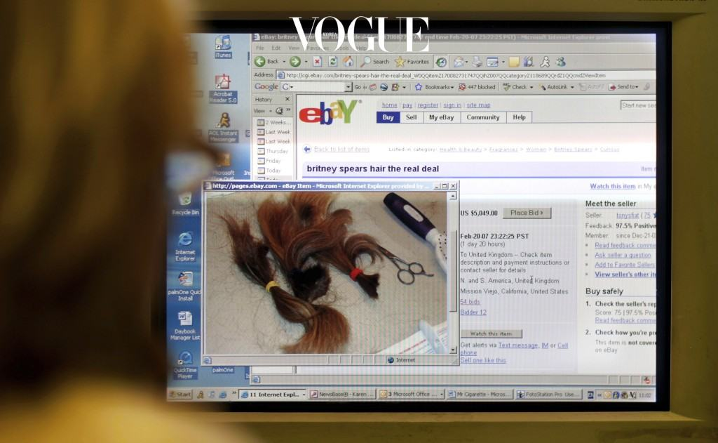 LONDON - FEBRUARY 19:  A woman looks at a computer screen displaying a page from online auction site Ebay with the locks of Britney Spears' hair for sale, photographed on February 19, 2007 in London.  Esther Tognozzi of Esther's Haircutting Studio in Tarzana, California has placed the locks of hair of the US singer on the the auction site after Spears used her clippers to shave her head on leaving a rehab clinic she had been resident at.  (Photo by Bruno Vincent/Getty Images)
