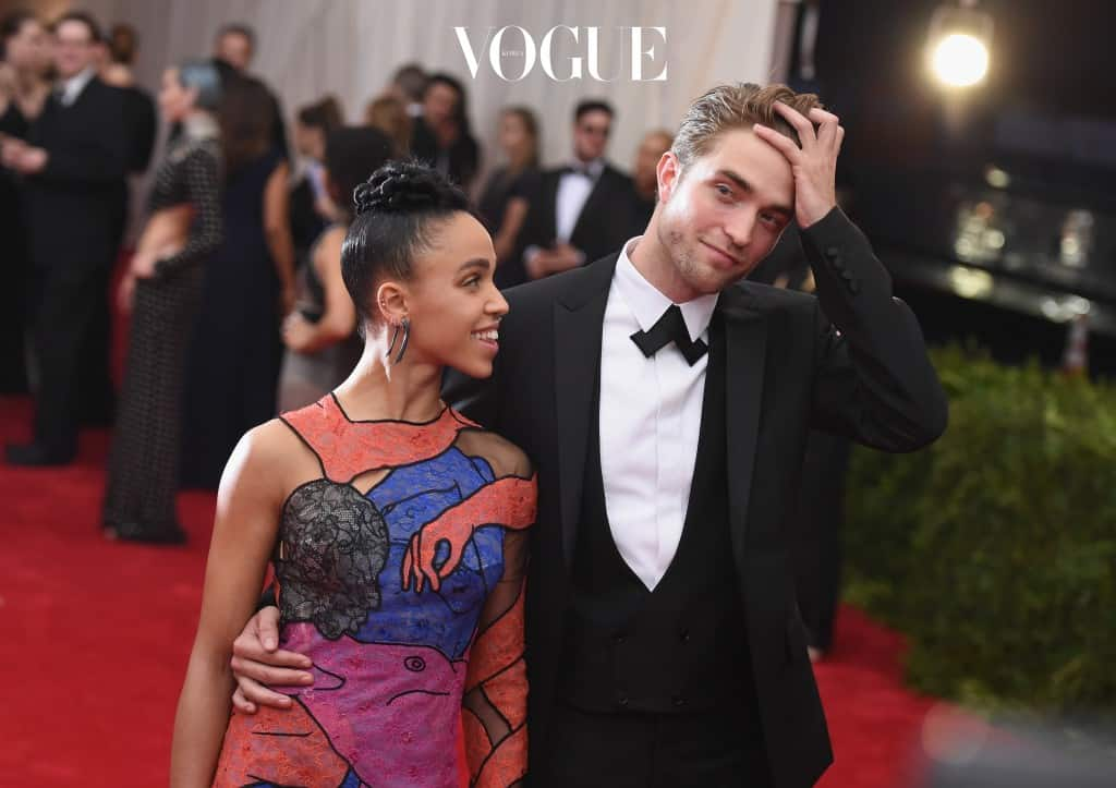 """NEW YORK, NY - MAY 04: FKA Twigs (L) and Robert Pattinson attend the """"China: Through The Looking Glass"""" Costume Institute Benefit Gala at the Metropolitan Museum of Art on May 4, 2015 in New York City.  (Photo by Mike Coppola/Getty Images)"""