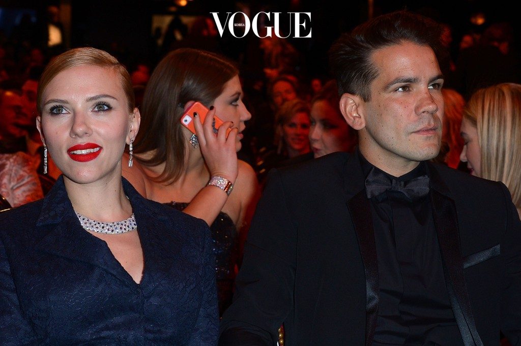PARIS, FRANCE - FEBRUARY 28:  Actress Scarlett Johansson and Romain Dauriac sit in the audience before the start of the 39th Cesar Film Awards 2014 at Theatre du Chatelet on February 28, 2014 in Paris, France.  (Photo by Dominique Charriau/Getty Images)