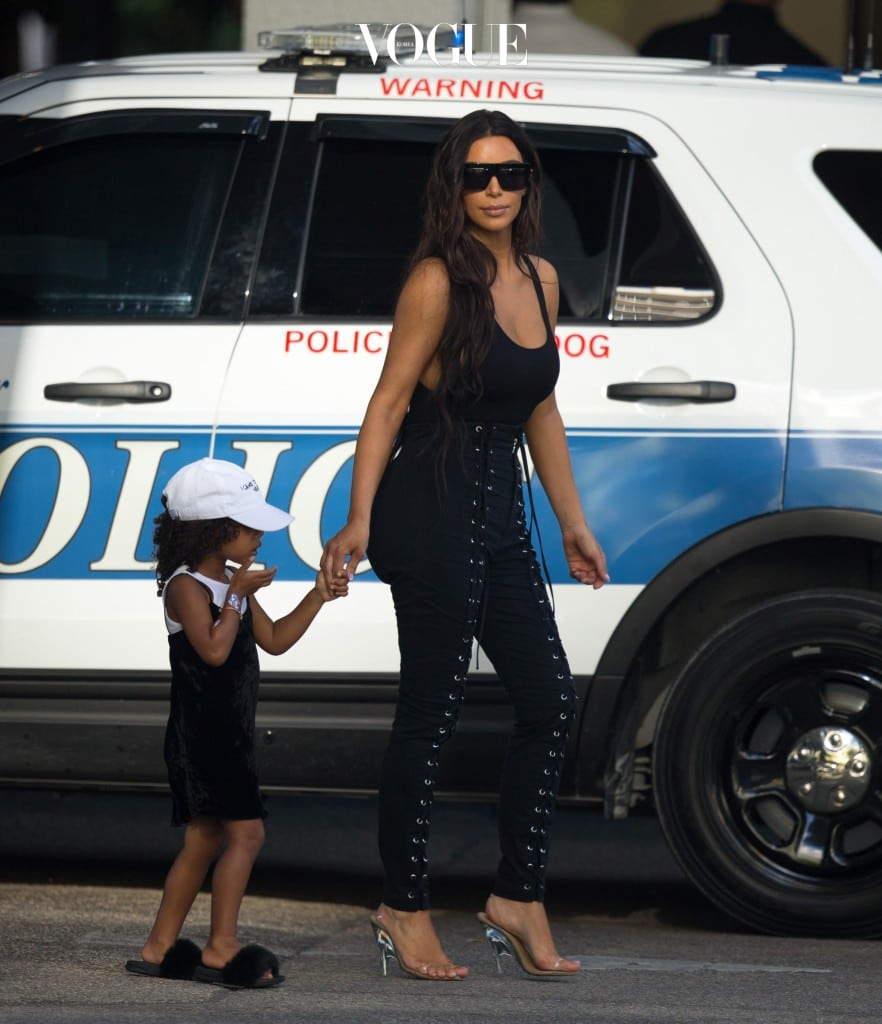 Kim Kardashian and daughter North West spotted leaving a lunch date with Khloe Kardashian and her new boyfriend Tristan Thompson at Carpaccio restaurant on Sunday in Miami, Florida. She walked past a police K9 Unit dog car with a Warning Police Work Dog sign on it. Ref: SPL1357523  180916   Picture by: Splash News Splash News and Pictures Los Angeles:310-821-2666 New York: 212-619-2666 London:870-934-2666 photodesk@splashnews.com