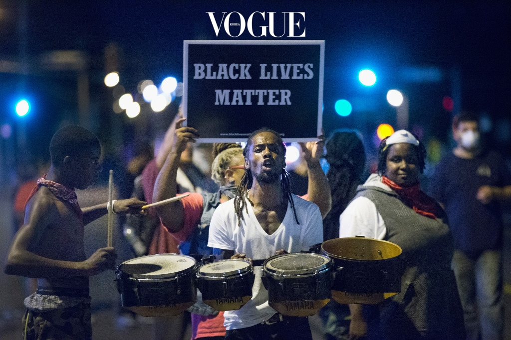 FERGUSON, MO - AUGUST 10:  Demonstrators, marking the one-year anniversary of the shooting of Michael Brown, protest along West Florrisant Street on August 10, 2015 in Ferguson, Missouri. Mare than 100 people were arrested today during protests in Ferguson and the St. Louis area. Brown was shot and killed by a Ferguson police officer on August 9, 2014. His death sparked months of sometimes violent protests in Ferguson and drew nationwide focus on police treatment of black suspects.  (Photo by Scott Olson/Getty Images)