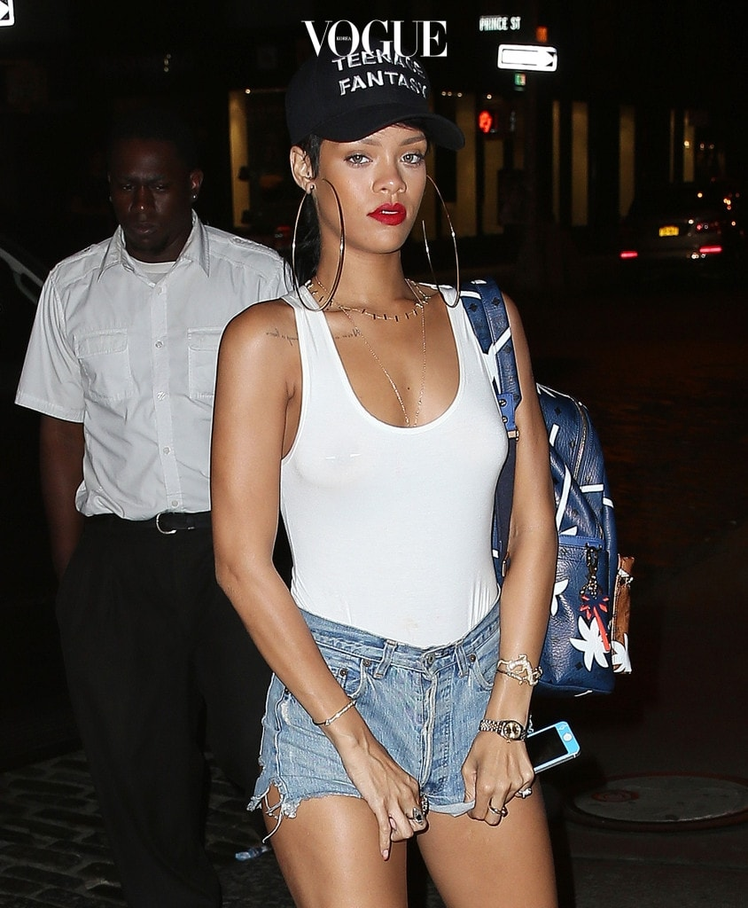 Rihanna wears a sheer top showing off her piercings while wearing a 'Teenage Fantasy' cap in NYC. Pictured: Rihanna Ref: SPL605656  040913   Picture by: Jackson Lee / Splash News Splash News and Pictures Los Angeles:310-821-2666 New York:212-619-2666 London:870-934-2666 photodesk@splashnews.com