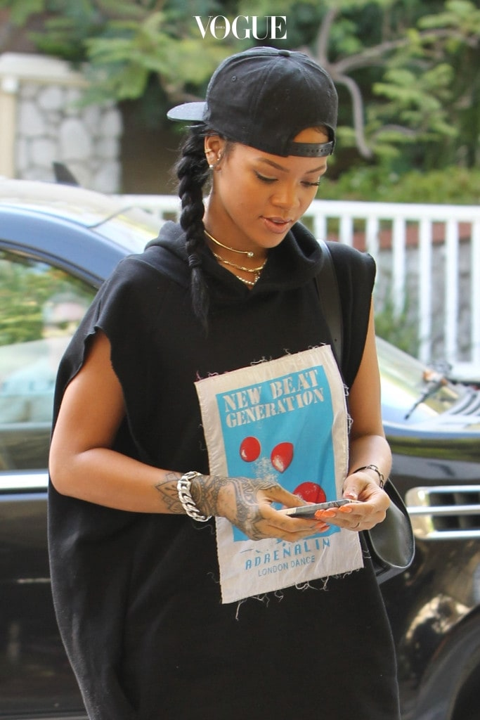 UK CLIENTS MUST CREDIT: AKM-GSI ONLY EXCLUSIVE: Rihanna arrived at the Sunset Marquis looking hip-hop chic in an oversized sleeveless graphic hoodie, shorts, colorful knee-high socks and Converse sneakers. Pictured: Rihanna Ref: SPL867502  161014   EXCLUSIVE Picture by: AKM-GSI / Splash News