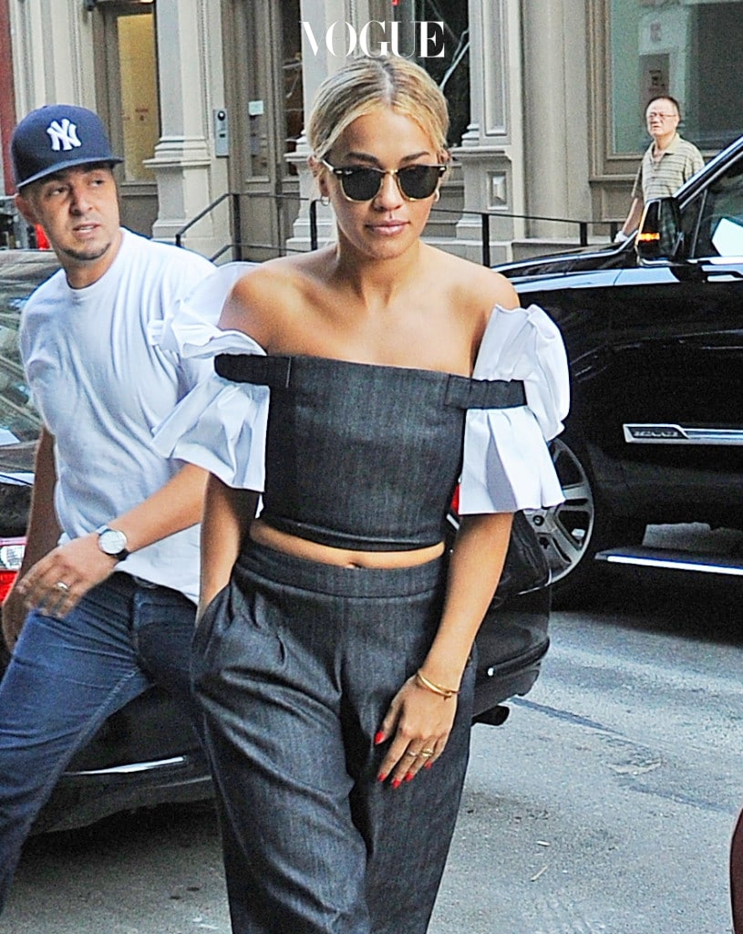 Rita Ora looks amazing in an off the shoulder blouse and also shows midriff while out in SoHo, New York City. Pictured: Rita Ora Ref: SPL1317800  120716   Picture by: Splash News Splash News and Pictures Los Angeles:310-821-2666 New York:212-619-2666 London:870-934-2666 photodesk@splashnews.com