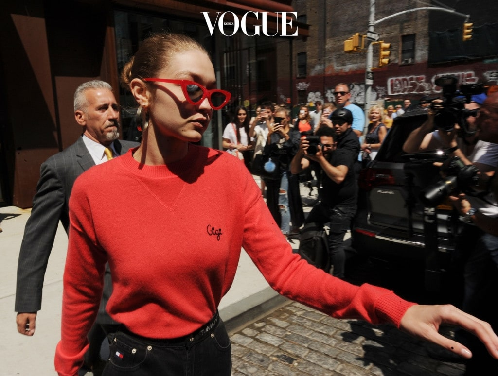 Gigi Hadid leaves her apt looking chic in New York City. The model had on some red sunglasses as she headed out to her awaiting suv. Pictured: Gigi Hadid Ref: SPL1510724  310517   Picture by: Jason Winslow / Splash News Splash News and Pictures Los Angeles:310-821-2666 New York:212-619-2666 London:870-934-2666 photodesk@splashnews.com