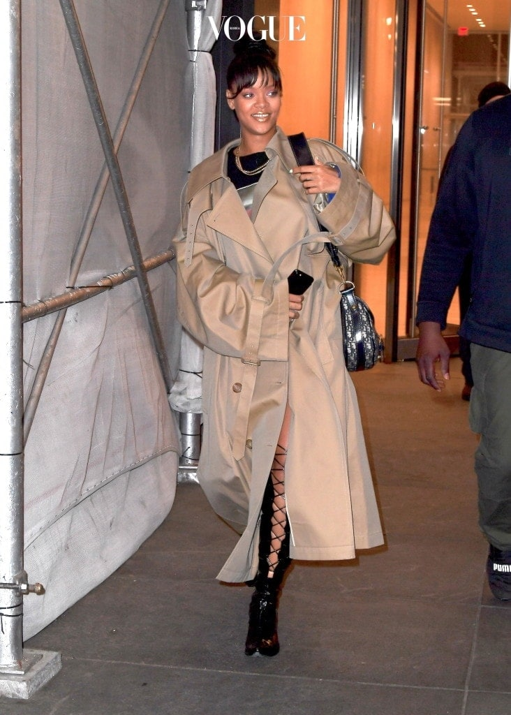 """Rihanna was spotted leaving a business meeting late on Wednesday night in NYC. The stunning singer showed off her beautiful smile after spending 4 hours discussing her upcoming """"Fenty Beauty"""" makeup line with her creative director Ciarra Pardo, and the rest of her team. She showed off a golden bronze lipstick, possibly from the upcoming line as she made her way out of the midtown office. She wore a giant Trench coat, stopping to lace up her thigh high black patent leather from designer, Ben Taverniti for Unravel Project Pictured: Rihanna Ref: SPL1492082  040517   Picture by: 247PAPS.TV / Splash News Splash News and Pictures Los Angeles:310-821-2666 New York:212-619-2666 London:870-934-2666 photodesk@splashnews.com"""