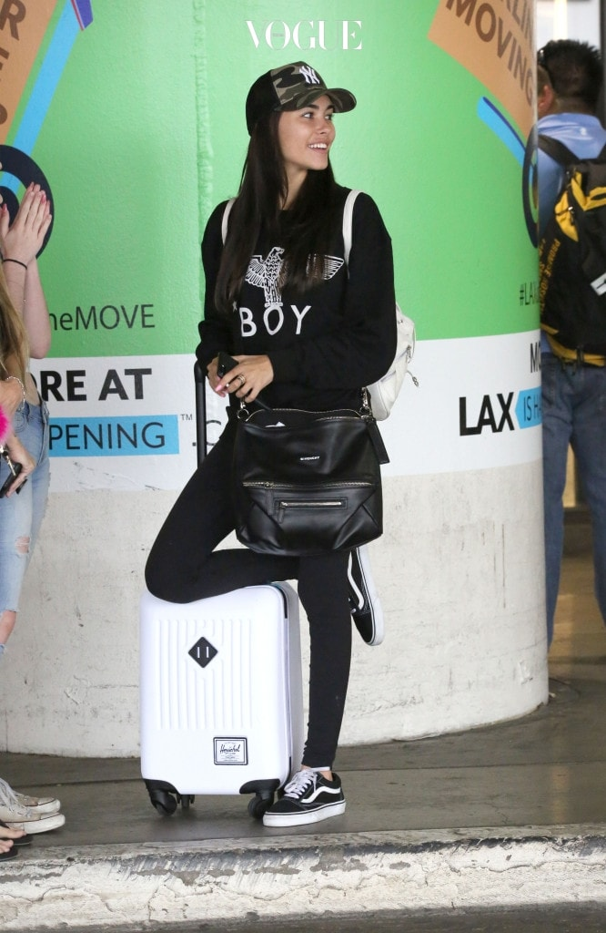 Madison Beer is seen arriving into Los Angeles only days after being snapped cuddling up to Brooklyn Beckham.  The adorable 18-year-old brunette was seen wearing a New York Yankees baseball cap, black pants and black and white Vans. Pictured: Madison Beer Ref: SPL1515559  080617   Picture by: Sharky/Polite Paparazzi/SPLASH Splash News and Pictures Los Angeles:310-821-2666 New York:212-619-2666 London:870-934-2666 photodesk@splashnews.com