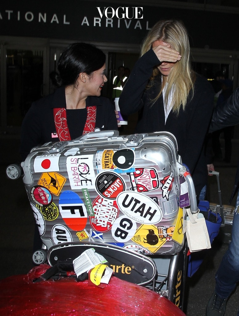 January 27th 2016 A camera shy Gwyneth Paltrow manages to moe down a waiting paparazzi with her sticker clad fancy luggage as she makes her way through Los Angele International Airport to a waiting limo.  Pictured: Gwyneth Paltrow Ref: SPL1216170  280116   Picture by: MOVI Inc. / Splash News Splash News and Pictures Los Angeles:310-821-2666 New York:212-619-2666 London:870-934-2666 photodesk@splashnews.com