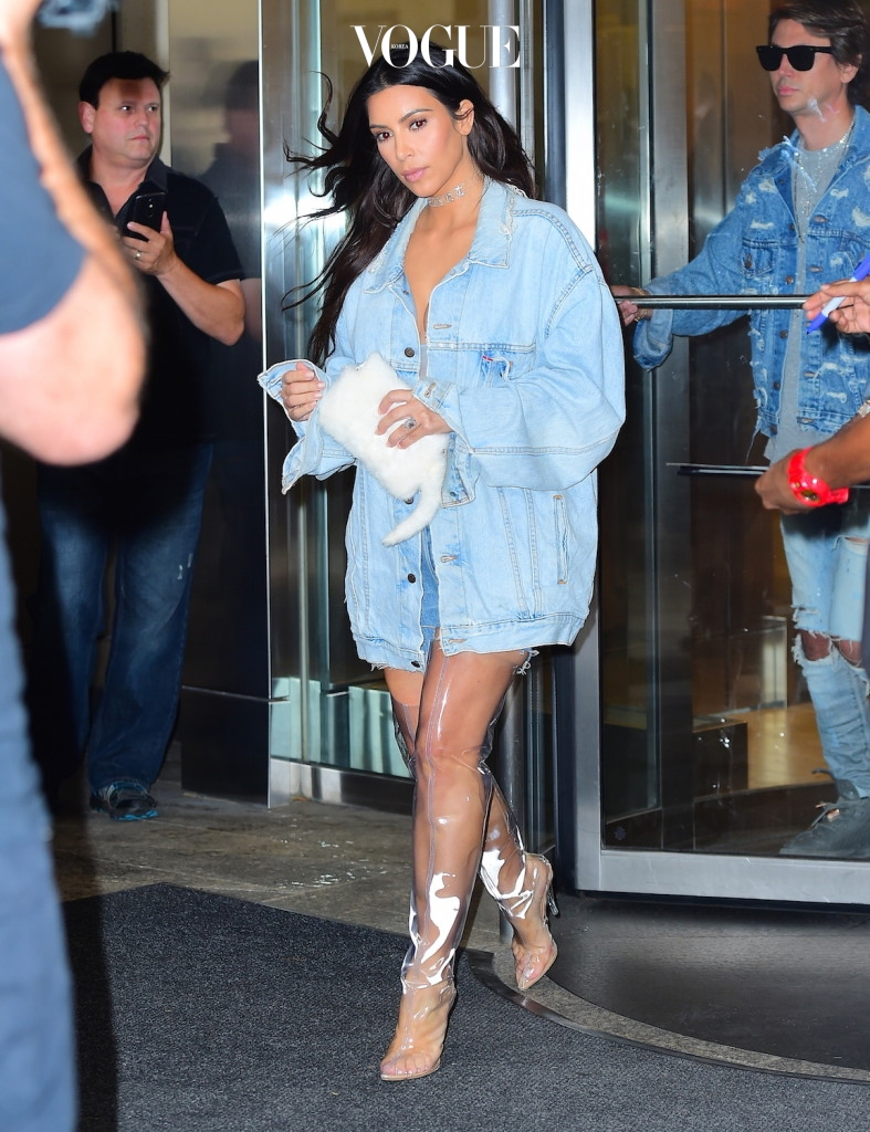 Kim Kardashian and BFF Jonathan Cheban were spotted filming for Keeping Up with the Kardashians in NYC on Tuesday afternoon. The two wore matching Double Denim as they were caught in a rain storm. They were escorted by burly security guards, and an umbrella holder as they left a midtown office building. Kim wore clear Yeezy Knee High boots. She was caught off guard when a huge gust of wind blew all of her hair across her face, before they made it to their car. Pictured: Kim Kardashian, Jonathan Cheban Ref: SPL1347263  060916   Picture by: 247PAPS.TV / Splash News Splash News and Pictures Los Angeles:310-821-2666 New York:212-619-2666 London:870-934-2666 photodesk@splashnews.com