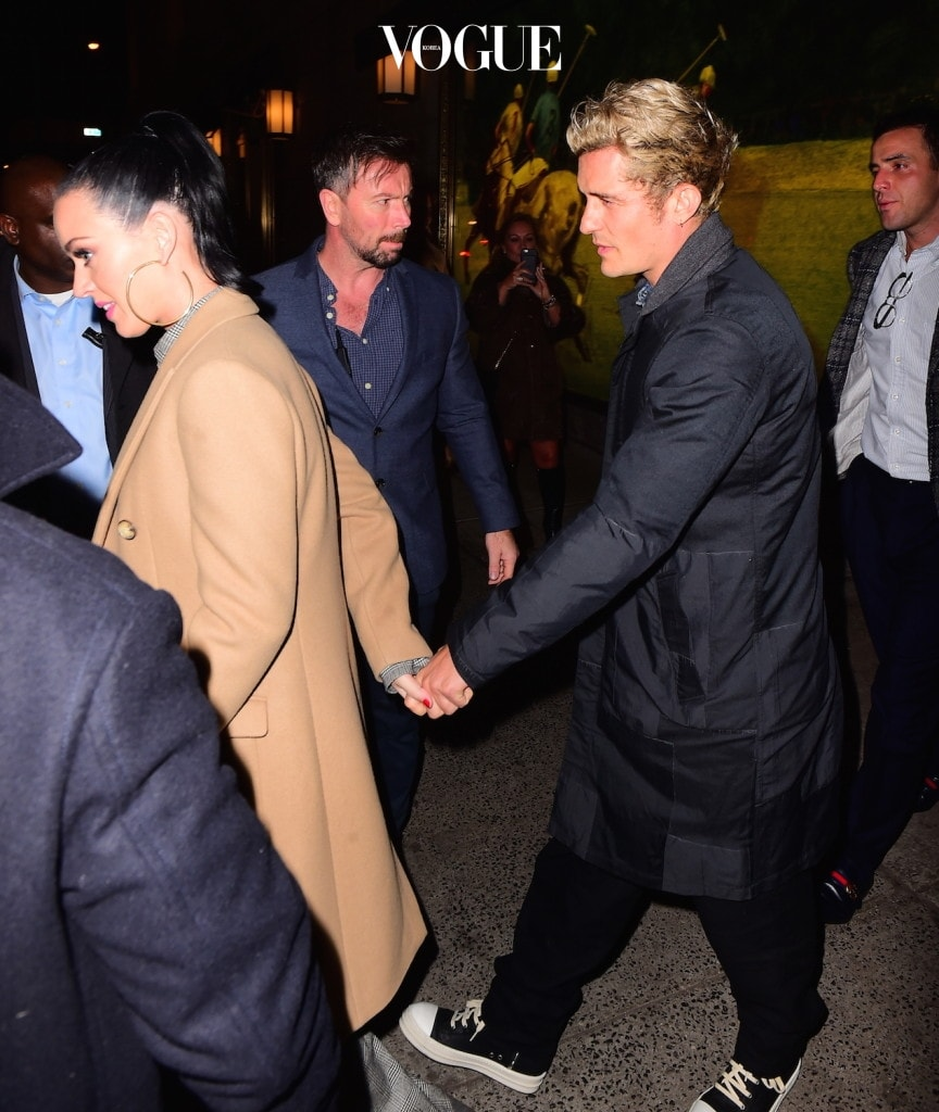 PREMIUM EXCLUSIVE RATES APPLY: **STRICTLY NO TV/WEB UNTIL 11.40AM PST WED NOV 30TH 2016** Katy Perry and Orlando Bloom recently faced breakup rumors, but they appear more together than ever as they enjoyed a night out in NYC. The couple enjoyed a date night at The Polo Bar in Midtown . They were joined by a few friends and a handful of bodyguards for the night on the town. They usually only have one bodyguard, but they opted for 3 this night. After leaving the restaurant at 11:30pm, they headed to a friends apartment in Soho. Katy showed off an enormous Yellow Diamond ring on THAT finger as she and Orlando walked happily together and held hands.  Pictured: Katy Perry, Orlando Bloom Ref: SPL1400943  301116   EXCLUSIVE Picture by: 247PAPS.TV / Splash News Splash News and Pictures Los Angeles:310-821-2666 New York:212-619-2666 London:870-934-2666 photodesk@splashnews.com