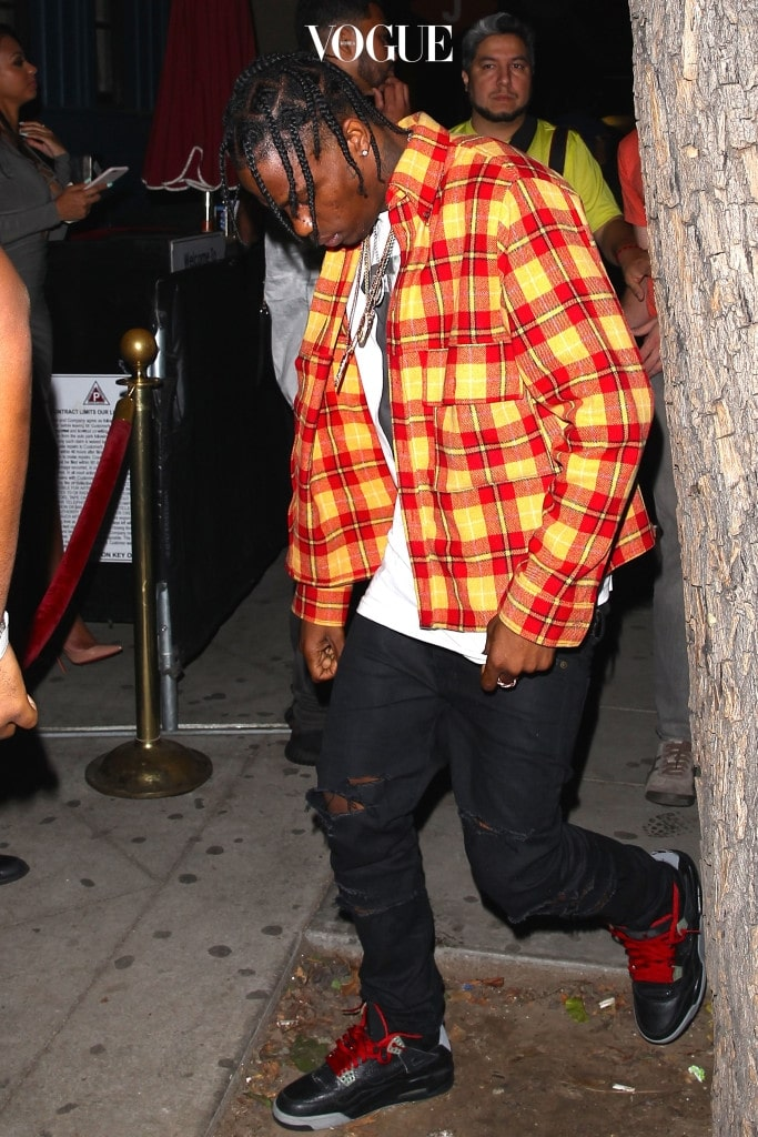 UK CLIENTS MUST CREDIT: AKM-GSI ONLY Travis Scott spends the evening hanging out with Rihanna at Hooray Henry's in West Hollywood. Pictured: Travis Scott Ref: SPL1131256  180915   Picture by: AKM-GSI / Splash News