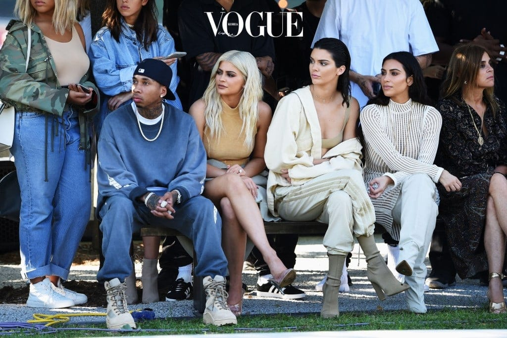 NEW YORK, NY - SEPTEMBER 07:  (L-R) Tyga, Kylie Jenner, Kendall Jenner, Kim Kardashian and Carine Roitfeld attend the Kanye West Yeezy Season 4 fashion show on September 7, 2016 in New York City.  (Photo by Jamie McCarthy/Getty Images for Yeezy Season 4)