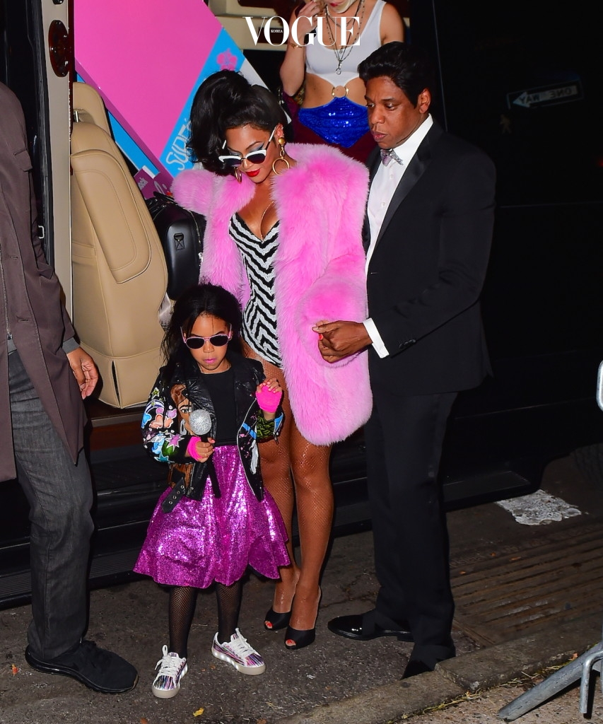 Beyonce and Jay Z were spotted arriving to their Annual Halloween Party in NYC . The couple dressed as a super stylish Black Barbie and Black Ken Doll set. Beyonce stunned in a Pink Fur Coat and a striped Bodysuit. She wore a mirrored pair of sunglasses as she walked with her Husband Jay Z and cute daughter Blue Ivy into the party. They were joined by Kelly Rowland as well, who dressed up as RUN DMC Pictured: Beyonce, Jay Z , Ref: SPL1384685  011116   Picture by: 247PAPS.TV / Splash News Splash News and Pictures Los Angeles:310-821-2666 New York:212-619-2666 London:870-934-2666 photodesk@splashnews.com