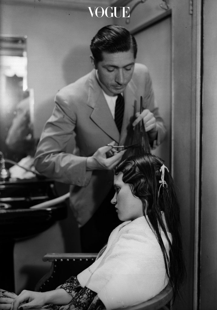 1938:  Hair stylist W H Semmens waving a woman's hair.  (Photo by General Photographic Agency/Getty Images)