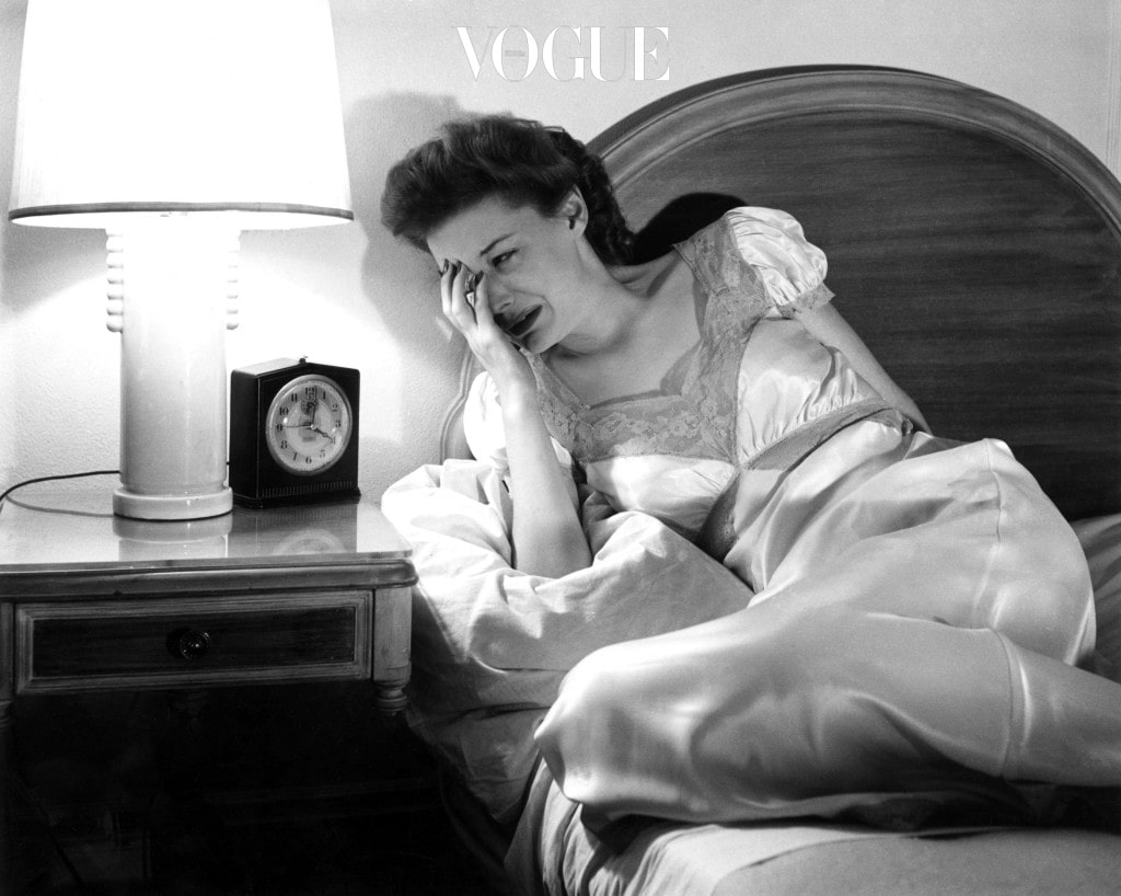 circa 1955: A woman crying as she looks at her bedside clock. (Photo by Three Lions/Getty Images)