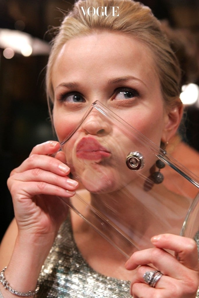 """BEVERLY HILLS, CA - JANUARY 16:  Actress Reese Witherspoon kisses at Access Hollywood """"Kiss For A Cause"""" benefiting the Film Foundation and the Hollywood Museum at the 63rd Annual Golden Globe Awards at the Beverly Hilton Hotel on January 16, 2006 in Beverly Hills, California. Exclusive.  (Photo by Mark Mainz/Getty Images for Access Hollywood)"""