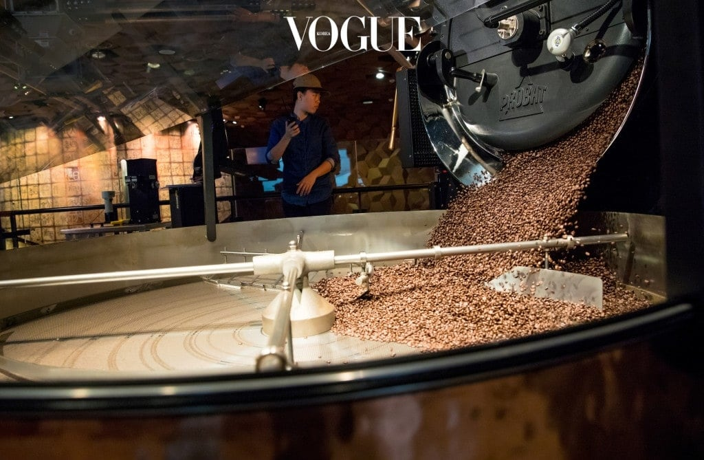 Roasted coffee spills into a cooling tray in the new Starbucks Roastery in Shanghai, China. Photographed on Friday, December 1, 2017.  (Joshua Trujillo, Starbucks)