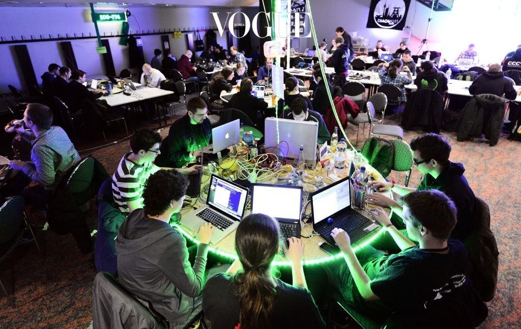 HAMBURG, GERMANY - DECEMBER 28:  Participants work at their laptops at the annual Chaos Computer Club (CCC) computer hackers' congress, called 29C3, on December 28, 2012 in Hamburg, Germany. The 29th Chaos Communication Congress (29C3) attracts hundreds of participants worldwide annually to engage in workshops and lectures discussing the role of technology in society and its future. (Photo by Patrick Lux/Getty Images)