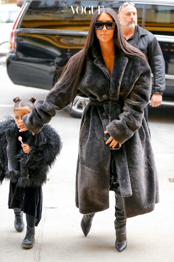 Kim Kardashian seen wearing her fake lip piercing while out and about with her kids North West and Saint West and her friend Jonathan Cheban in New York City, they where arriving at Cipriani in SoHo. Pictured: Kim Kardashian and North West Ref: SPL1433278  010217   Picture by: Felipe Ramales / Splash News Splash News and Pictures Los Angeles:310-821-2666 New York:212-619-2666 London:870-934-2666 photodesk@splashnews.com