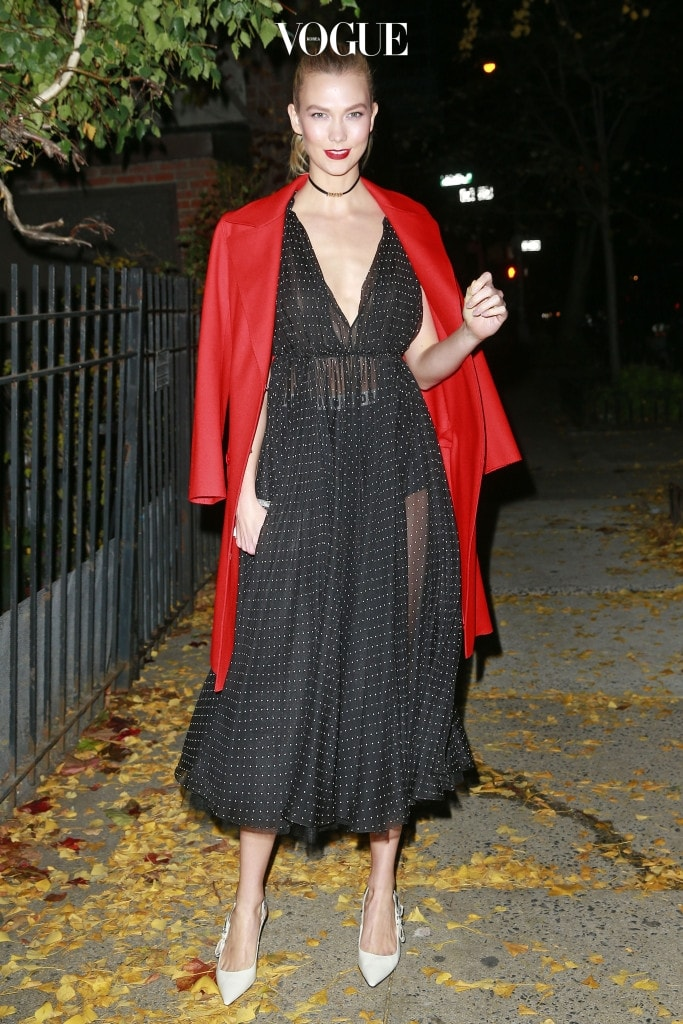 Karlie Kloss wears a red jacket over her a floral dress while heading to the Guggenheim International gala with Dior in New York City, NY. Pictured: Karlie Kloss Ref: SPL1395657  171116   Picture by: SRPP / Splash News Splash News and Pictures Los Angeles:310-821-2666 New York:212-619-2666 London:870-934-2666 photodesk@splashnews.com