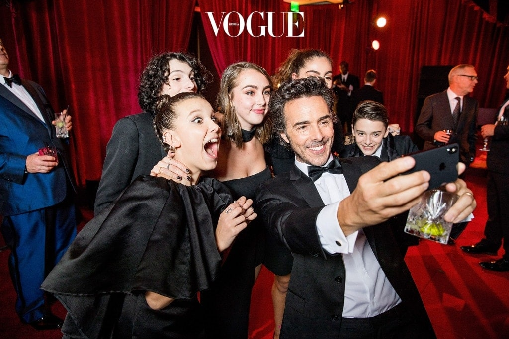 BEVERLY HILLS, CA - JANUARY 07: In this handout photo provided by Netflix,  Millie Bobby Brown, Finn Wolfhard, Shawn Levy and Noah Schnapp attend the Netflix Golden Globes after party at Waldorf Astoria Beverly Hills on January 7, 2018 in Beverly Hills, California.  (Photo by Netflix via Getty Images)
