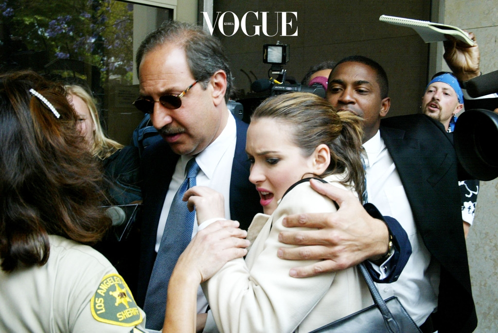 BEVERLY HILLS, CA - JUNE 3:  Actress Winona Ryder and her attorney, Mark J. Geragos,  arrive at the Beverly Hills Municipal Court for her preliminary hearing on  shoplifting charges on June 3, 2002 in Beverly Hills, CA.  Ryder was injured trying to make her way through a crowd of photographers.  The actress left court a short while later to seek medical attention.  (Photo by Frazer  Harrison/Getty Images)