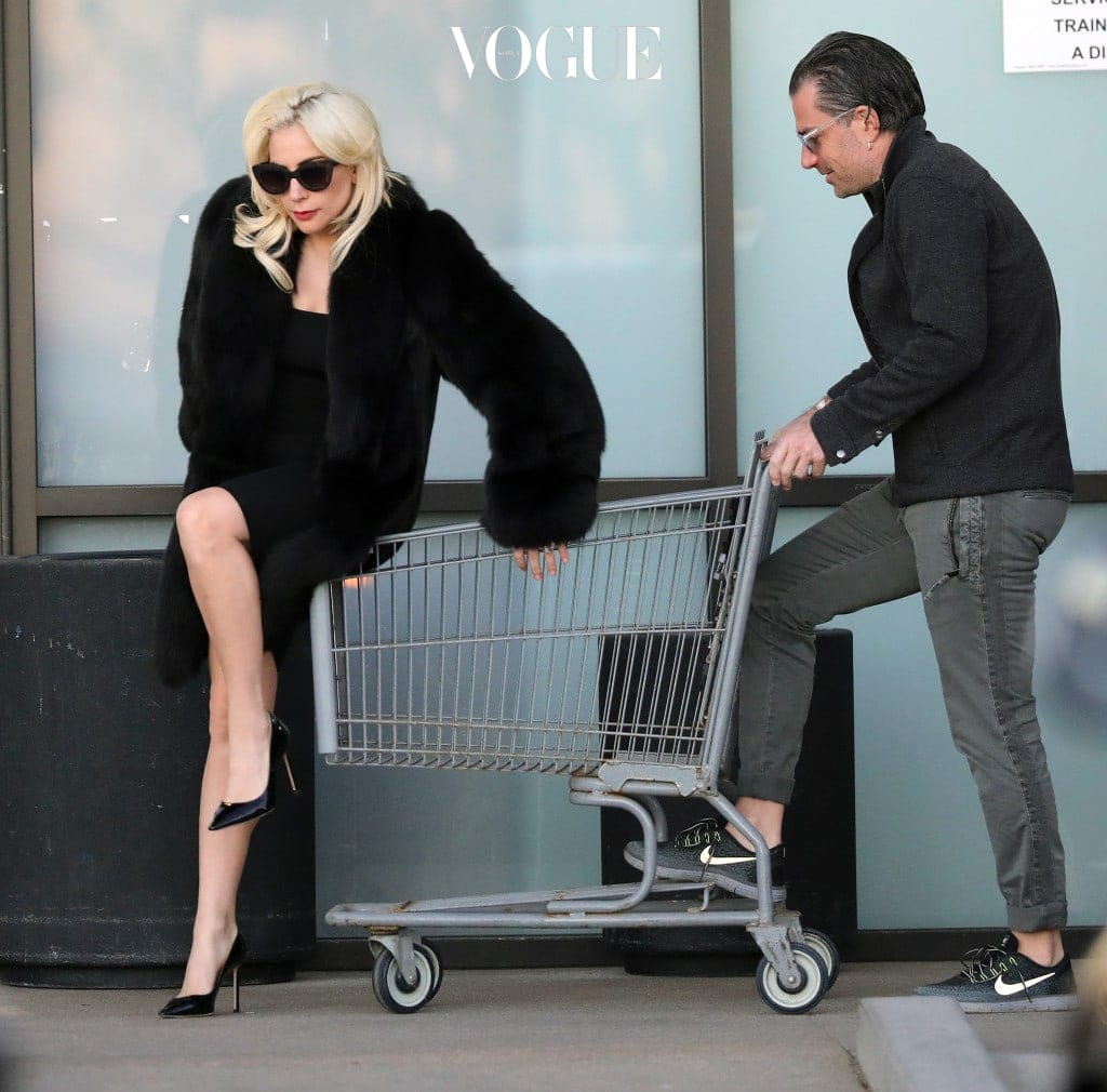 EXCLUSIVE: **NO WEB UNTIL 10PM PST ON DECEMBER 22, 2017**NO NY PAPERS**PREMIUM EXCLUSIVE RATES APPLY**Lady Gaga does her groceries in true diva fashion as she gets a shopping cart ride from fiancé Christian Carino in Malibu California. Gaga, who reportedly got engaged to Carino in October this year, hopped into the cart as the pair arrived at Trancas Country Market on December 21, 2017. The pop star, who was clad in a black dress, faux fur coat and heels, stunned shoppers by climbing into the cart so her beau could push her around the store. The pair later emerged from the store carrying a shopping bag and walked back to their car. Pictured: Lady Gaga, Christian Carino Ref: SPL1640103  221217   EXCLUSIVE Picture by: Jacson / Splash News Splash News and Pictures Los Angeles:310-821-2666 New York:212-619-2666 London: 870-934-2666 photodesk@splashnews.com