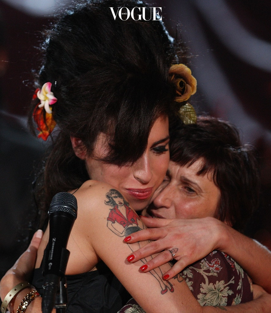 LONDON - FEBRUARY 10: British singer Amy Winehouse (L) hugs her mother Janis Winehouse after accepting a Grammy Award at the Riverside Studios for the 50th Grammy Awards ceremony via video link on February 10, 2008 in London, England. Winehouse won 5 out of her 6 nominations including, record of the year, best new artist, song of the year, pop vocal album and female pop vocal performance. (Photo by Peter Macdiarmid/Getty Images for NARAS)